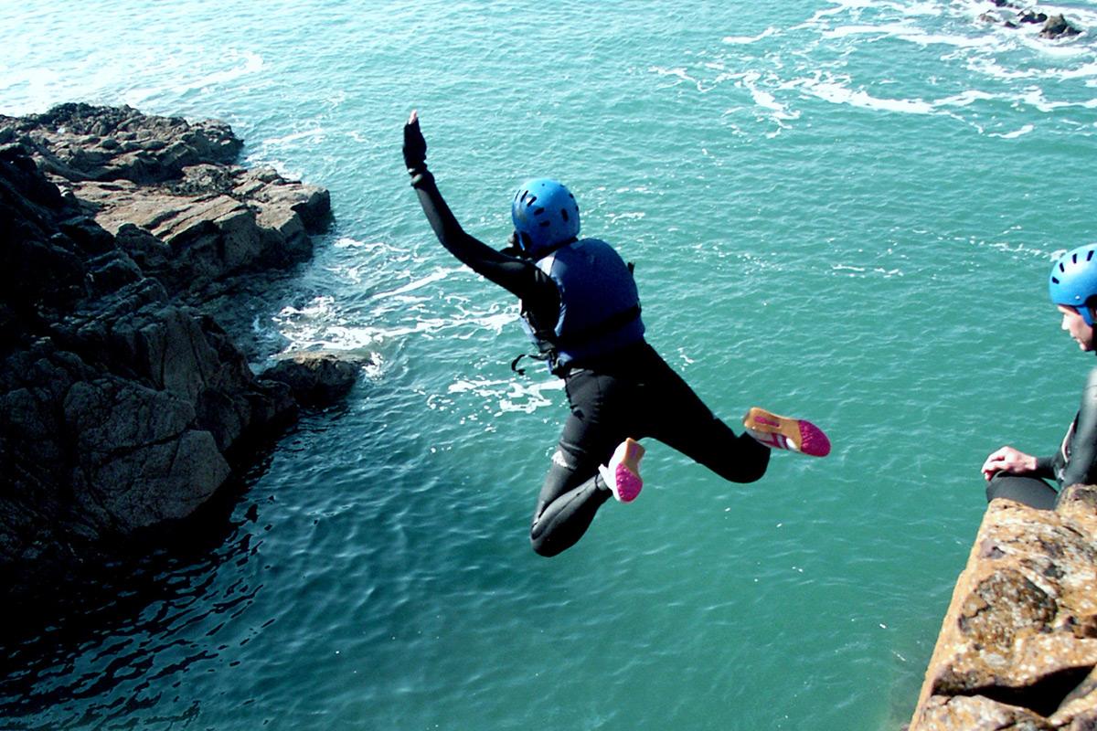cliff jump coasteering in Cornwall