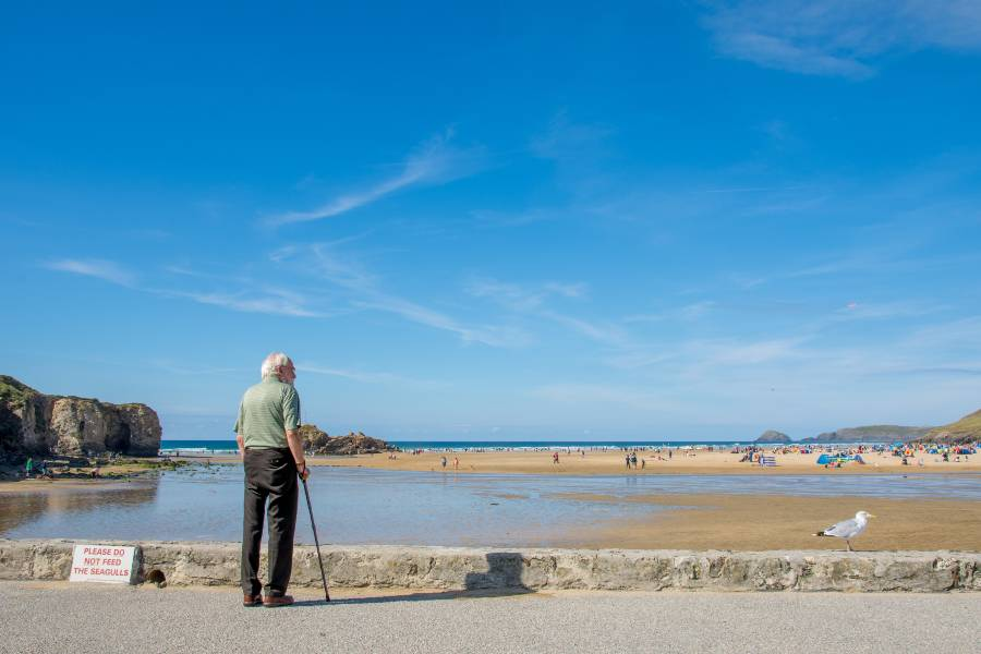 Disabled man walking at Perranporth in Cornwall